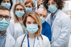 Group picture of healthcare professionals looking at camera.
